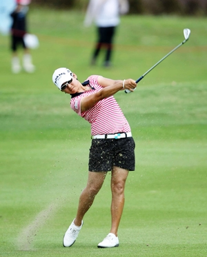 Tseng strikes an iron into the green during her final round.