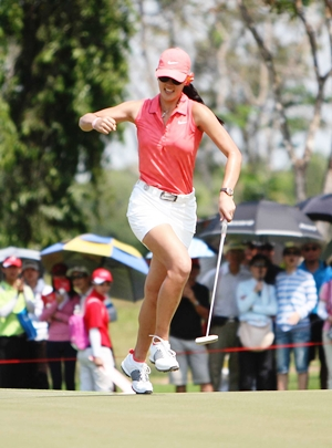 Michelle Wie celebrates after birdying the first hole.