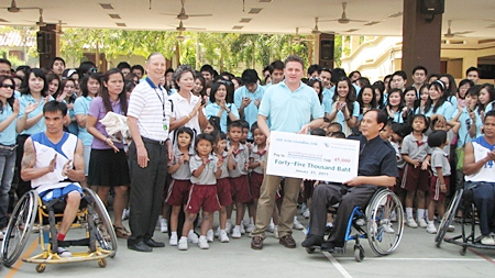 Brett Hayes, general manager for Thailand and Vietnam of Invida (Thailand) led his staff of 340 people to visit the Father Ray Foundation recently, where they received a warm welcome by the children under the care of the centre. They were treated to a game of wheelchair basketball played by handicapped students of the Redemptorist Vocational School.  Mr. Hayes presented 45,000 baht to Udomchoke Choorat, director of the school. In addition Invida also sponsored foundation t-shirts valued at 8000 baht.