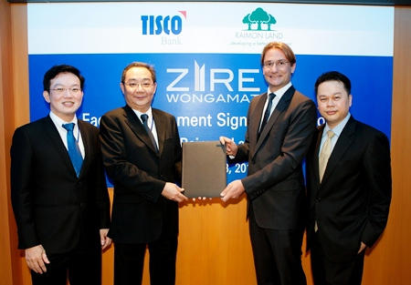 Raimon Land Chief Executive Officer Hubert Viriot and TISCO Bank Plc. President Suthas Ruangmanamongkol sign the THB 1,027 million project financing agreement for Zire Wongamat. Also shown in the photo are Kitti Tangsriwong (far right), COO Raimon Land and Sakchai Peechapat (far left), Senior Executive Vice President, TISCO Bank Plc.