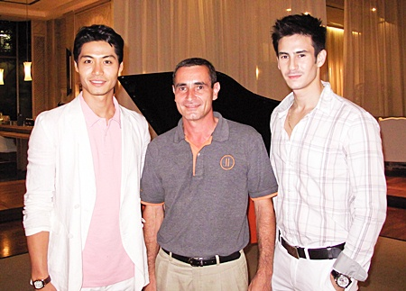 """Serge Rigodin (centre), operations manager of the Pullman Pattaya Aisawan greets Korean movie actor Lee Kwan Hoon and Vincent """"Vinnie"""" Kinny, Thailand's top male model, who were at the resort to shoot a 'Thailand Society' television segment."""