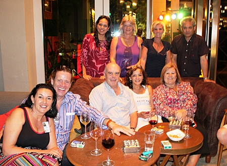 Bea Grunwell (standing 2nd left), president of the Pattaya International Ladies Club (PILC), Jeena Saguansap (standing left), Tea Tree Spa manager, Tracy Cosgrove (seated right) and a group of friends enjoy good fellowship during the Lighthouse Club Charity networking event at Holiday Inn Pattaya recently.
