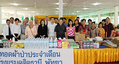 As part of the resort's corporate social responsibility initiatives, Chatchawal Supachayanont (centre), general manager of Dusit Thani Pattaya led his hotel management and staff to perform their monthly merit-making activities by donating a large quantity of amenities and foodstuffs to the Jittapawan Temple and Buddhist College to mark Makha Bucha Day on February18.