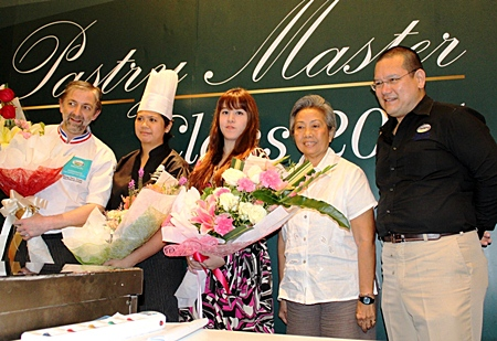 "French Chef Jean-Francois Arnaud (left), recipient of the ""Un des Meilleurs Ouvriers de France en patisserie confiserie"" in 2000 was at the Holiday Inn Pattaya recently to attend the Master Pastry Chef Class 2011 organised by the Biz Portal Co. Ltd. Participants were chefs from international brand hotels in Pattaya, bakeries and restaurants who were interested in learning the fine art of making confections and pastries from the master chef himself."