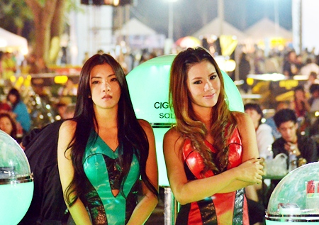 A pair of promotion girls take time out to enjoy the music.