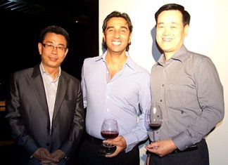 Thomas Koh (RM Garden Cliff Resort), Alex Chakrabarti (GM Mercure Hotel) and Somkhit Tonsaiphet (GM Zign Hotel) enjoy a pre dinner cocktail.