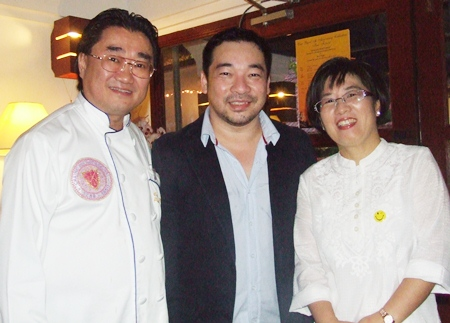 Pascal (left) and Kim (right) welcome Koh Mr. Saxman to the restaurant's 10th anniversary celebration.