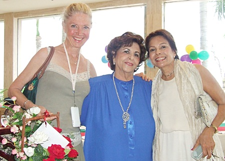 Arlette hugs dear friends Lela and Rita.