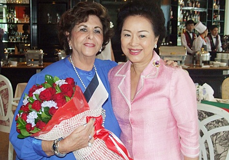 Khun Panga presents Arlette with a bouquet of red roses.