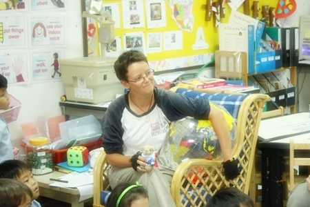 Catherine and Mee Nooi, a bear that travelled with her on the trip, answering questions at Garden International School.