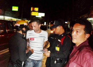 Sebastian Guillaume is arrested at a checkpoint on Pratamnak Road in Jomtien Beach.