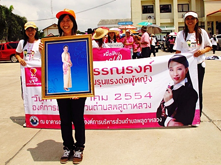 Women in Plutaluang take to the streets to bring awareness to the 'Say No to Violence Against Women' campaign.