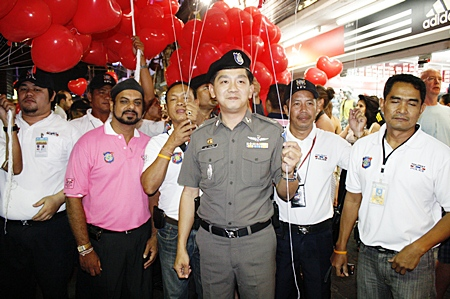 Pattaya Tourist Police commander Maj. Col. Arun Prompan (center) during the Valentine's Day red balloon giveaway on Walking Street.