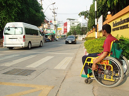 Students with disabilities sometimes have a tough time in front of the school, as they need to wait for kind drivers to allow them to cross the road.