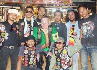 "Some members of the ""Life Appreciation Club"", led by club president Akarapol Yaram, pose for a photo with some members of the Burapha Motorbike Club."