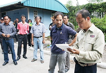 Bankai Sub-district Mayor Sanit Putsang instructs a Mit Steel manager to clean drains and construct a storage tank in order to reduce toxic effects on the neighboring villagers.