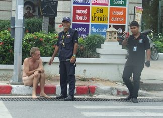Volunteers try to persuade the naked man to dress.