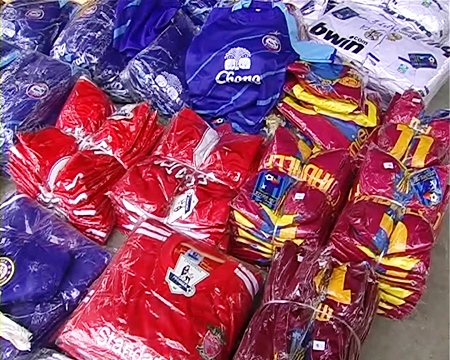 Officers found large quantities of counterfeit brand-name clothing items.