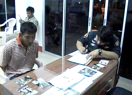 Niwat Suda, left, helps police with their enquires after being arrested on Wednesday, March 2.