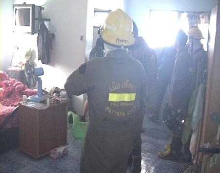 Firefighters clear up after dousing the fire at the R-Con Apartments on Soi Doodee last Thursday.