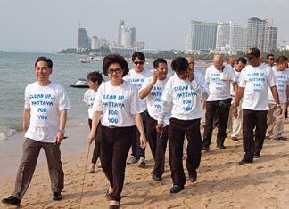 Vasana Khwanmuang, 3rd left, leads volunteers on a beach cleaning exercise on Monday, March 14.