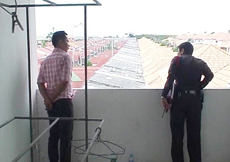 A police officer checks the rooftop where the thieves apparently entered the building.