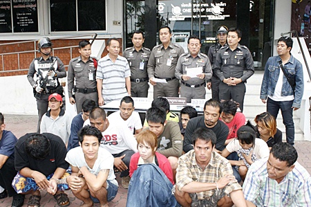 The alleged drug dealers are detained at Banglamung Police Station as the charges are read out.