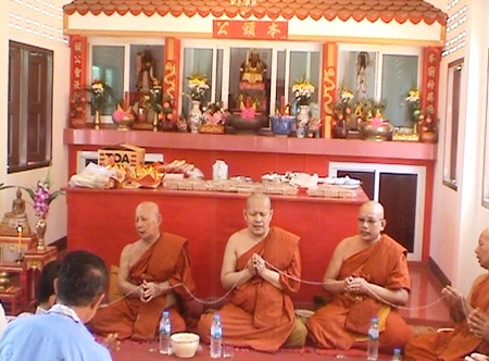 Buddhist monks attend the ceremony in Rong Poh as residents there prayed for prosperity and protection from the Sea God.