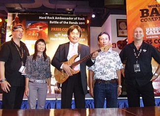 "Pattaya Deputy Mayor Ronakit Ekasingh, center, opens the ""battle of the bands"" concert at the Ambassador Hotel on February 26."