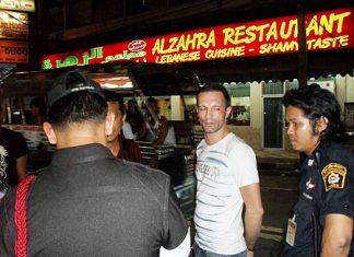 French national Sebastian Gillami is arrested by Pattaya police on Pratamnak Road, Sunday.