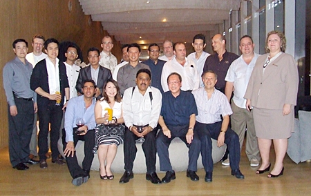 The hotel GMs and other invited guests pose for a group photo at the Hilton Pattaya.