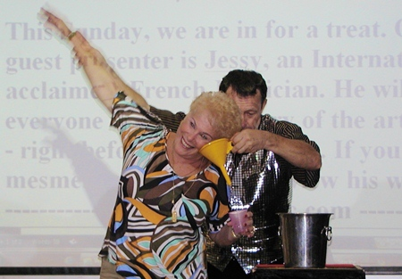 Water on the brain - who needs a doctor? French magician Jessy shows Pattaya City Expats members his quick & simple cure, aided by the lovely Suzanne.