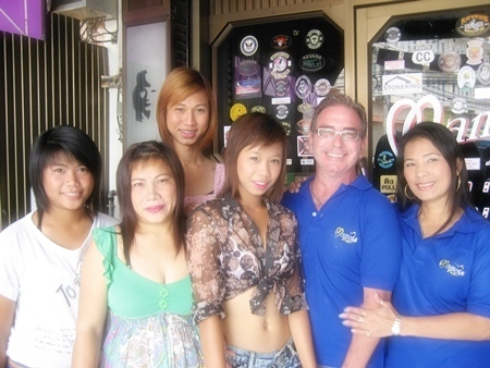Winner Andy Oz (2nd right) celebrates with the staff at Mama's Bar.