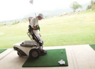 Jens Maspfuhl demonstrates his new Power-Golfer wheelchair.