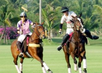 Thai Polo and St. Regis battle for possession of the ball at the Queen's Cup Pink Polo event held at Thai Polo Club in Pattaya, Saturday, February 19.