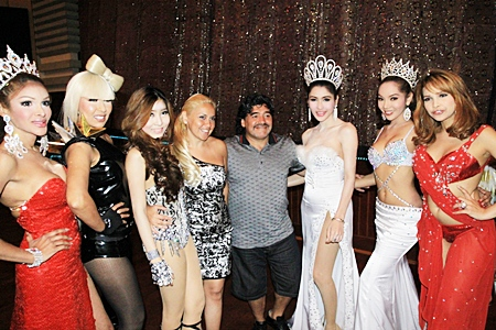 Argentinean football legend Diego Armando Maradona (center right) and his girlfriend Veronica Ojeda (center left) meet some of the stars of the Alcazar cabaret show on Friday, March 4.