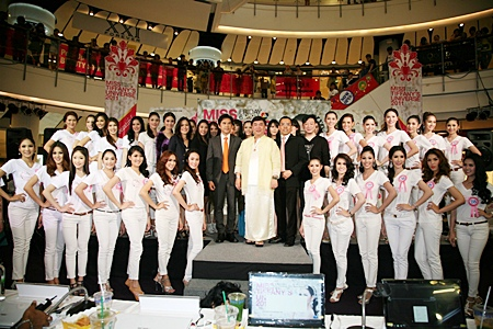 Hopeful contestants line up with organizing committee members and sponsors at Central World in Bangkok for the announcement of the 2011 Miss Tiffany's Universe 2011 beauty pageant.