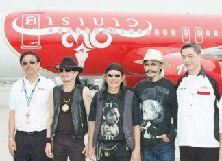 (L to R) Preechaya Rasametanin, Thai AirAsia's Director of Engineering; Carabao's Thierry, Add and Lek and Tassapon Bijleveld, CEO of Thai AirAsia.