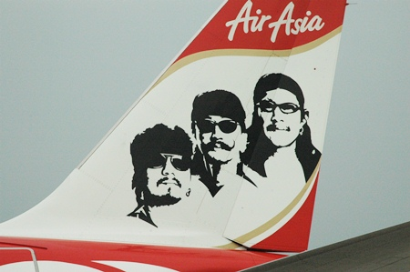 The plane's tail carries the picture of Thierry, Lek and Add Carabao.