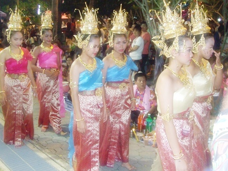 Beautiful goddesses follow the head deity in a procession around the festival grounds to inspect the food on offer.