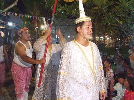The head deity leads the procession to inspect the food on offer.