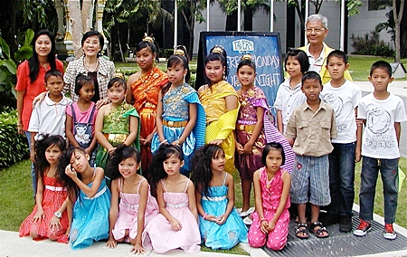 Toy (rear, 2nd from left) and staff of Pattaya Orphanage pose with the their 'angels'.