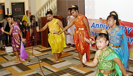 "Toy's ""Angels"", otherwise known as the delightful children from Pattaya Orphanage, perform a traditional Thai dance to help PCEC members celebrate its ten years."