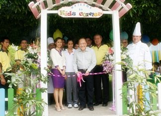 Supachayanont cuts the ribbon during the opening of the Kids Corner.