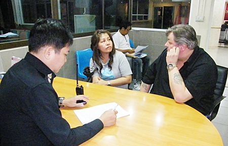 Gunnar Nordal (right) is questioned about his involvement with Kiss a-Go-Go on Soi LK Metro.