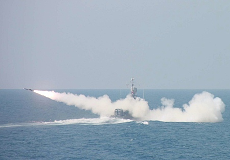 "Navy forces fire an Exocet missile from the HTMS Ratcharit, a fast-attack boat, during regularly scheduled military exercises in the Gulf of Thailand near Sattahip.  Whilst watching the exercises, Supreme Commander Gen. Songkitti Jaggabatara said that Thai forces were ""resolute"" in protecting the country's sovereignty."