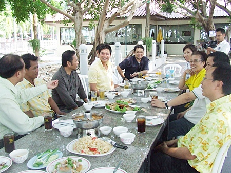 The Naklua Songkran organizing committee meets at Plathong Restaurant to discuss preparations for the Naklua Wan Lai Festival.