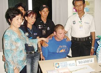 Owner Araya Lertkitsathaporn (left) and tourist police volunteers managed to detain Alexander Trofimenko.