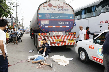 The victim of the road traffic accident lies prostrate next to the fuel tanker with which he collided on his motorcycle in Naklua, Thursday, March 30.