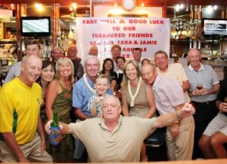 Seamus Cotter, front center, and his family say farewell to their friends at Lewiinski's